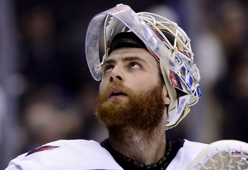 Washington Capitals goaltender Braden Holtby (70) looks on during first-period NHL hockey game action against the Toronto Maple Leafs in Toronto, Thursday, Feb. (Frank Gunn/The Canadian Press via AP)