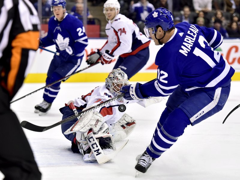 Toronto Maple Leafs center Patrick Marleau (12) looks on as Washington Capitals goaltender Braden Holtby (70) stops his shot during first-period NHL hockey game action in Toronto, Thursday, Feb. (Frank Gunn/The Canadian Press via AP)