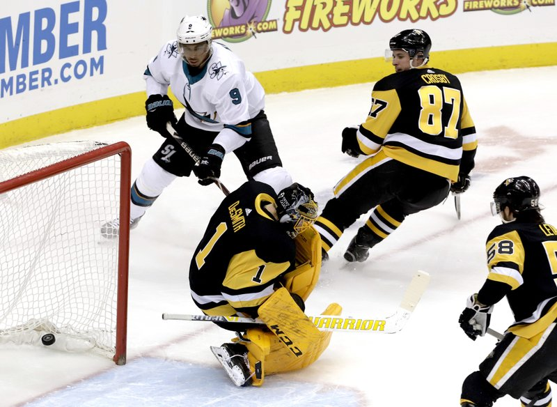 San Jose Sharks' Evander Kane (9) puts the puck behind Pittsburgh Penguins goaltender Casey DeSmith (1) for a goal in the first period of an NHL hockey game in Pittsburgh, Thursday, Feb. (AP Photo/Gene J. Puskar)