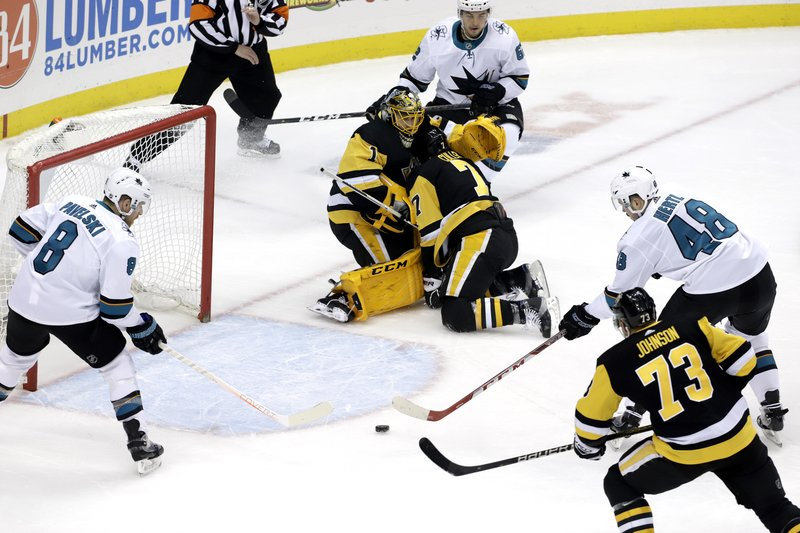 San Jose Sharks' Tomas Hertl (48) collects a rebound off Pittsburgh Penguins goaltender Casey DeSmith (1) for his second goal of the first period during an NHL hockey game in Pittsburgh, Thursday, Feb. (AP Photo/Gene J. Puskar)