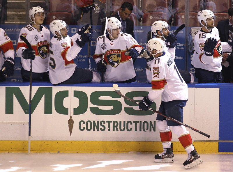 Florida Panthers' Jonathan Huberdeau (11) celebrates with teammates after scoring a goal during the second period of an NHL hockey game against the Carolina Hurricanes, Thursday, Feb. (AP Photo/Luis M. Alvarez)