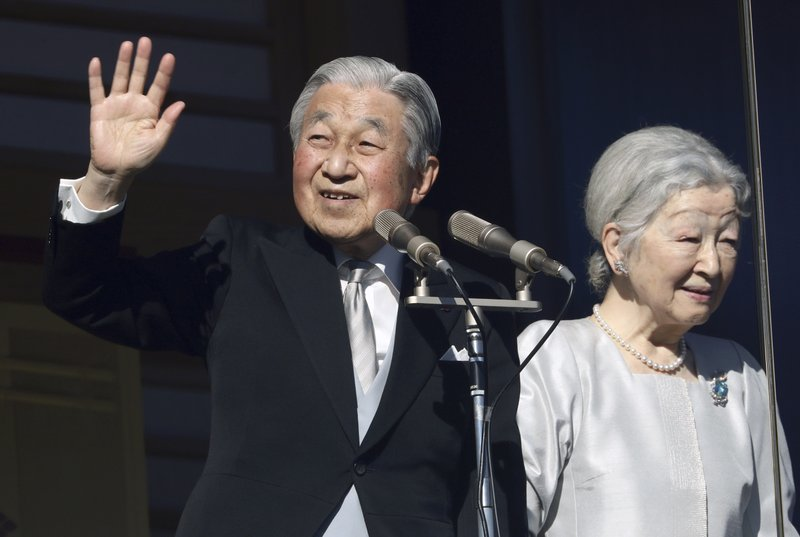 FILE - In this Jan. 2, 2019, file photo, Japan's Emperor Akihito and Empress Michiko greet to well-wishers from the bullet-proofed balcony during his New Year's public appearance with his family members at Imperial Palace in Tokyo. (AP Photo/Eugene Hoshiko, File)
