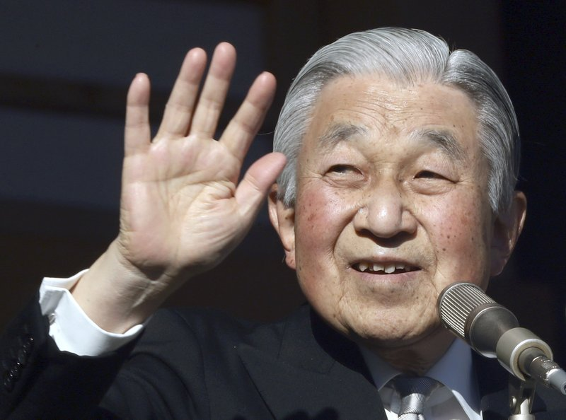 FILE - In this Jan. 2, 2019, file photo, Japan's Emperor Akihito waves to well-wishers from the bullet-proofed balcony during his New Year's public appearance with his family members at Imperial Palace in Tokyo. (AP Photo/Eugene Hoshiko, File)