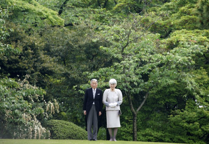 FILE - In this April 25, 2018, file photo, Japan's Emperor Akihito and Empress Michiko attend a spring garden party at the Akasaka Palace imperial garden in Tokyo. (AP Photo/Eugene Hoshiko, File)