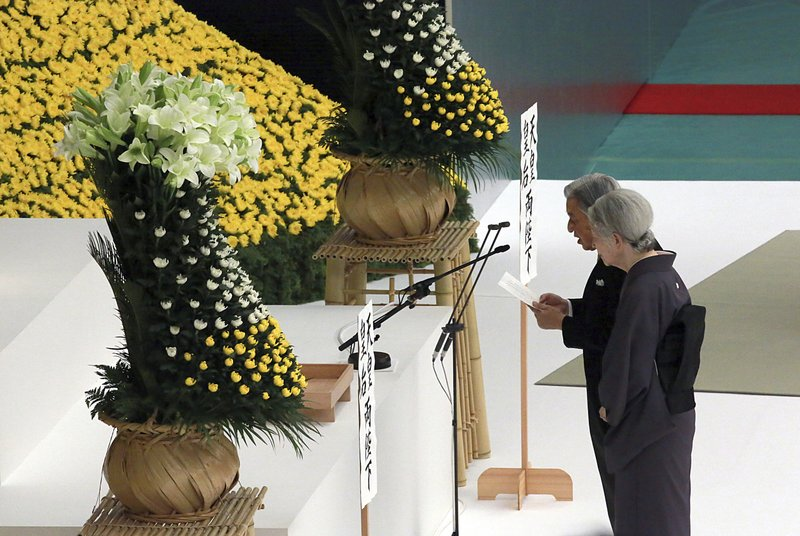 FILE - In this Aug. 15, 2018, file photo, Japan's Emperor Akihito delivers his remarks with Empress Michiko during a memorial service at Nippon Budokan martial arts hall in Tokyo. (AP Photo/Eugene Hoshiko, File)