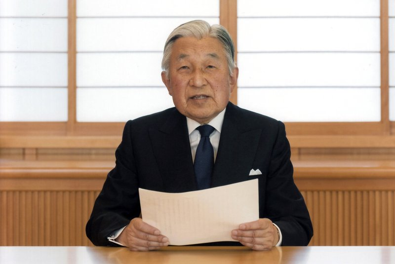 In this Aug. 7, 2016, file photo, provided by the Imperial Household Agency of Japan on Monday, Aug. 8, 2016, Japan's Emperor Akihito reads a message for recording at the Imperial Palace in Tokyo. (Imperial Household Agency of Japan via AP, File)