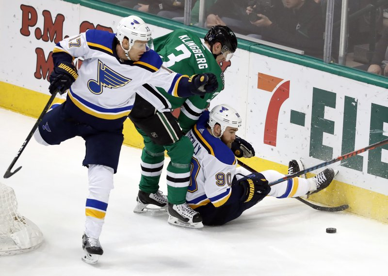 St. Louis Blues left wing Jaden Schwartz (17) and center Ryan O'Reilly (90) work against Dallas Stars defenseman John Klingberg (3) for control of the puck during the first period of an NHL hockey game in Dallas, Thursday, Feb. (AP Photo/Tony Gutierrez)