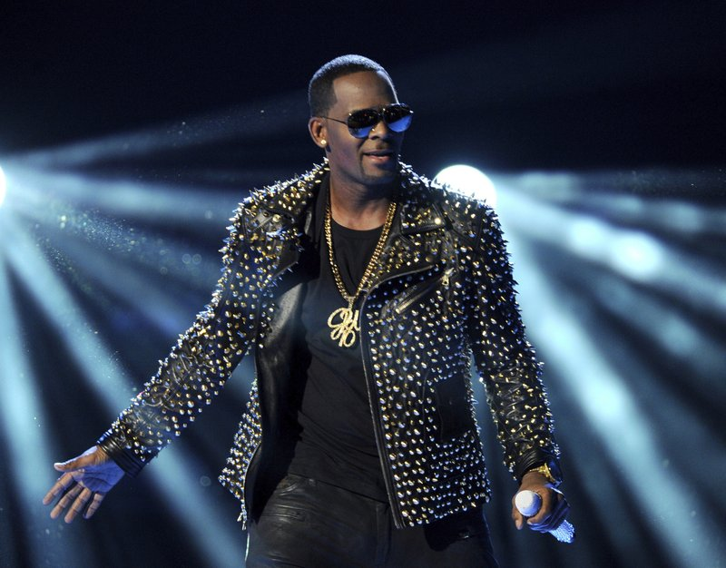 FILE - In this June 30, 2013 file photo, R. Kelly performs at the BET Awards in Los Angeles. Prosecutors will have to clear a series of high legal hurdles if they intend to charge R. (Photo by Frank Micelotta/Invision/AP, File)
