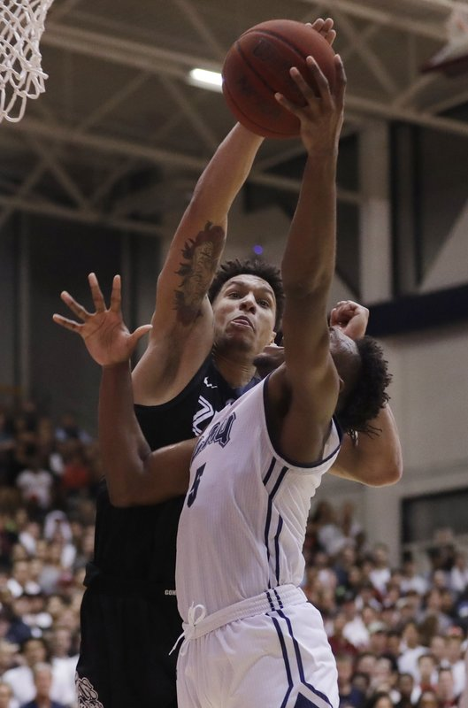 Gonzaga forward Brandon Clarke, left, blocks a shot from Loyola Marymount guard James Batemon during the second half of an NCAA basketball game Thursday, Feb. (AP Photo/Marcio Jose Sanchez)