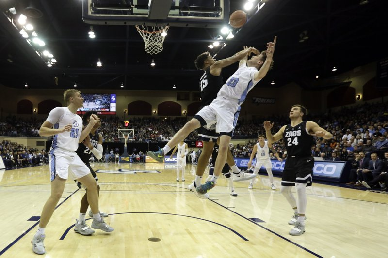 Gonzaga forward Brandon Clarke, center, blocks a shot by San Diego guard Finn Sullivan during the first half of an NCAA college basketball game Saturday, Feb. (AP Photo/Gregory Bull)