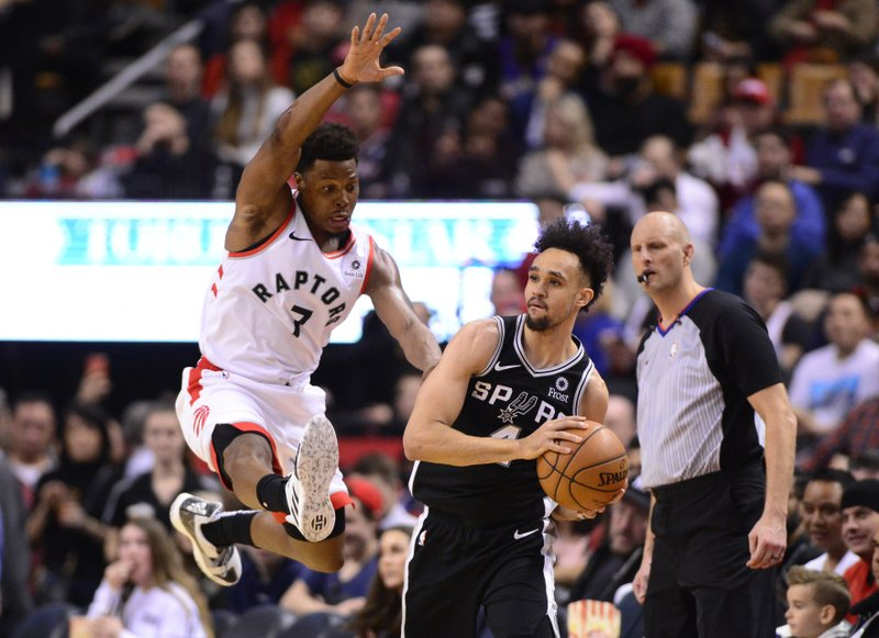Toronto Raptors guard Kyle Lowry (7) jumps in front of San Antonio Spurs guard Derrick White (4) during the second half of an NBA basketball game Friday, Feb. (Frank Gunn/The Canadian Press via AP)