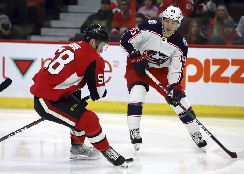 Columbus Blue Jackets' Matt Duchene's (95) shot is blocked by Ottawa Senators' Maxime Lajoie (58) during first-period NHL hockey game action in Ottawa, Ontario, Friday, Feb. (Fred Chartrand/The Canadian Press via AP)