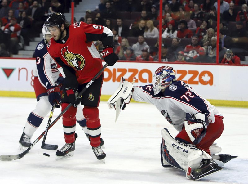 Ottawa Senators' Bobby Ryan (9) battles with Columbus Blue Jackets' Seth Jones (3) as Blue Jackets goaltender Sergei Bobrovsky (72) keeps his eyes on the puck during second-period NHL hockey game action in Ottawa, Ontario, Friday, Feb. (Fred Chartrand/The Canadian Press via AP)