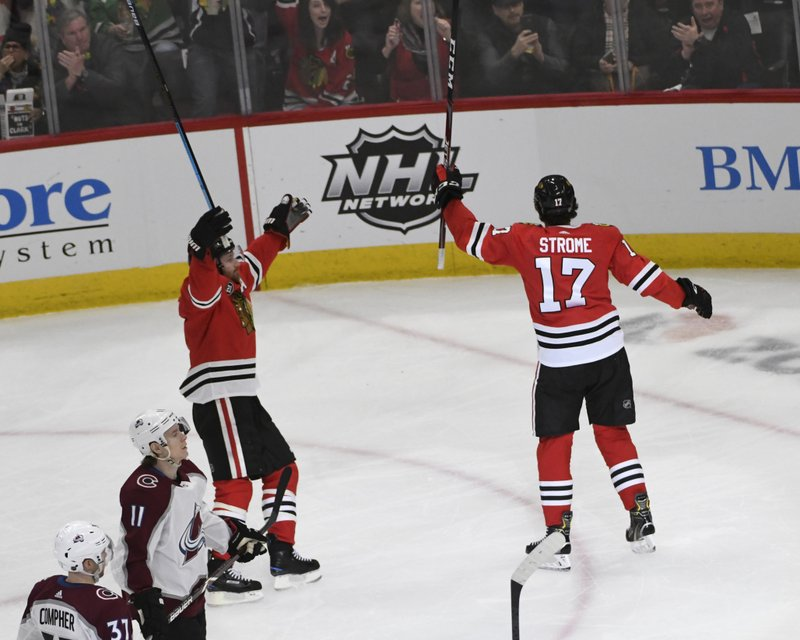 Chicago Blackhawks center Dylan Strome (17) celebrates his goal against the Colorado Avalanche with defenseman Duncan Keith (2) during the second period of an NHL hockey game Friday, Feb. (AP Photo/David Banks)