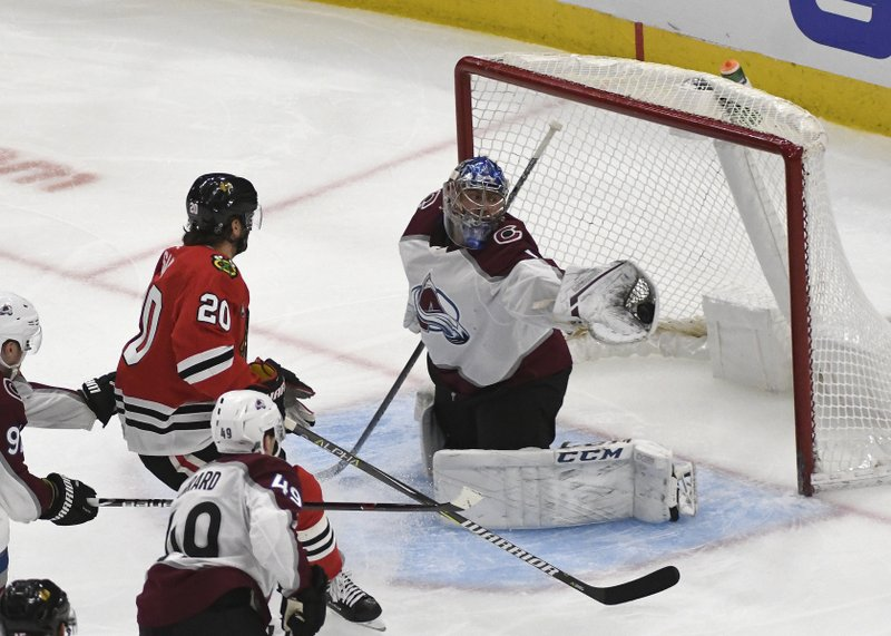 Colorado Avalanche goaltender Semyon Varlamov (1) makes a save against Chicago Blackhawks left wing Brandon Saad (20) during the second period of an NHL hockey game Friday, Feb. (AP Photo/David Banks)