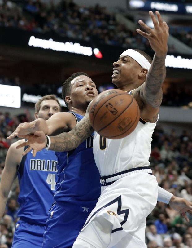 Dallas Mavericks guard Jalen Brunson (13) strips the ball away from Denver Nuggets guard Isaiah Thomas (0) on a shot attempt during the first half of an NBA basketball game in Dallas, Friday, Feb. (AP Photo/Tony Gutierrez)