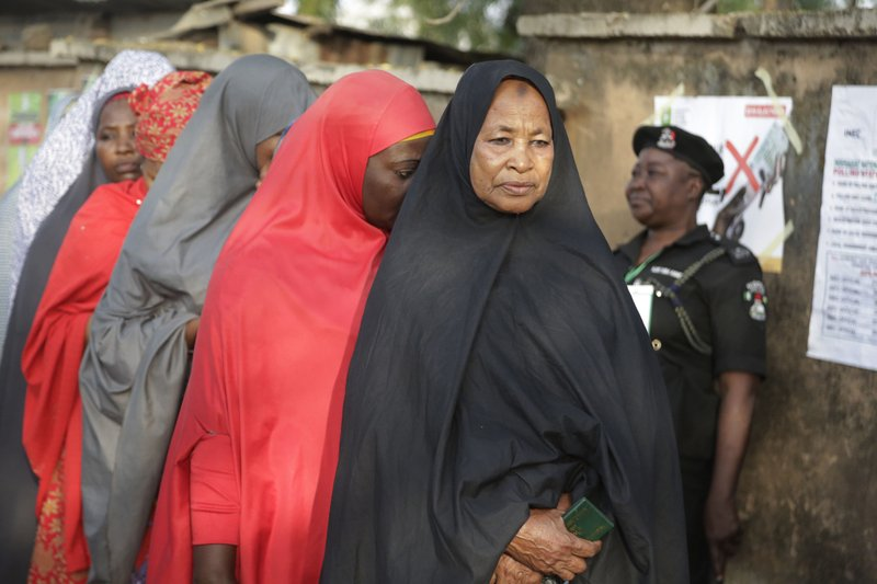 Women wait in queue to cast their votes during Presidential and National Assembly election in Yola, Nigeria, Saturday, Feb. (AP Photo/Sunday Alamba)