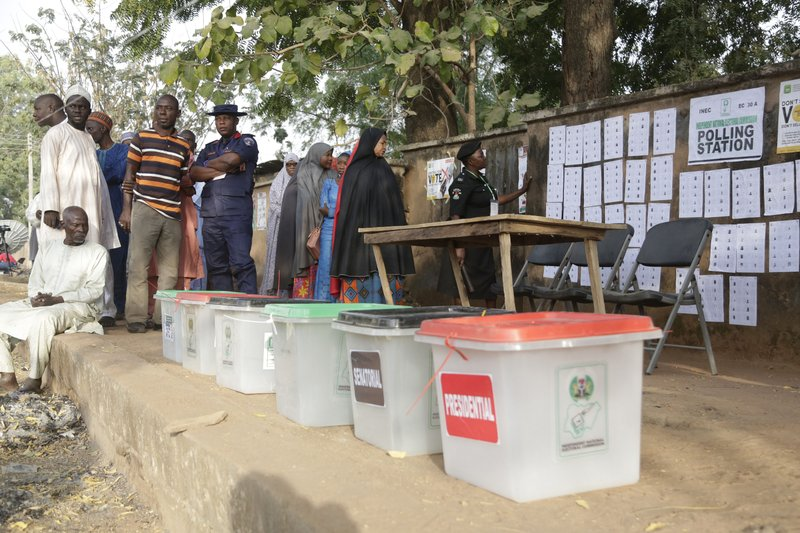 Voters line up to cast their votes during Presidential and National Assembly election in Yola Nigeria, Saturday, Feb. (AP Photo/Sunday Alamba)
