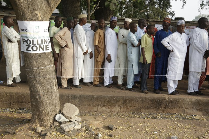 Voters line up to cast their votes during the Presidential and National Assembly election in Yola Nigeria, Saturday, Feb. (AP Photo/Sunday Alamba)