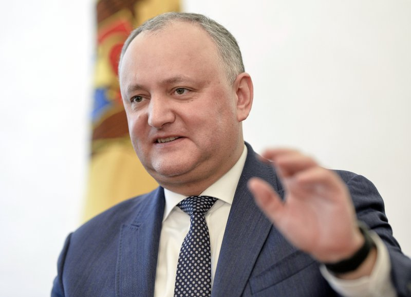 Moldova's President Igor Dodon gestures, during an interview with the Associated Press in Chisinau, Moldova, Thursday, Feb. (AP Photo/Andreea Alexandru)
