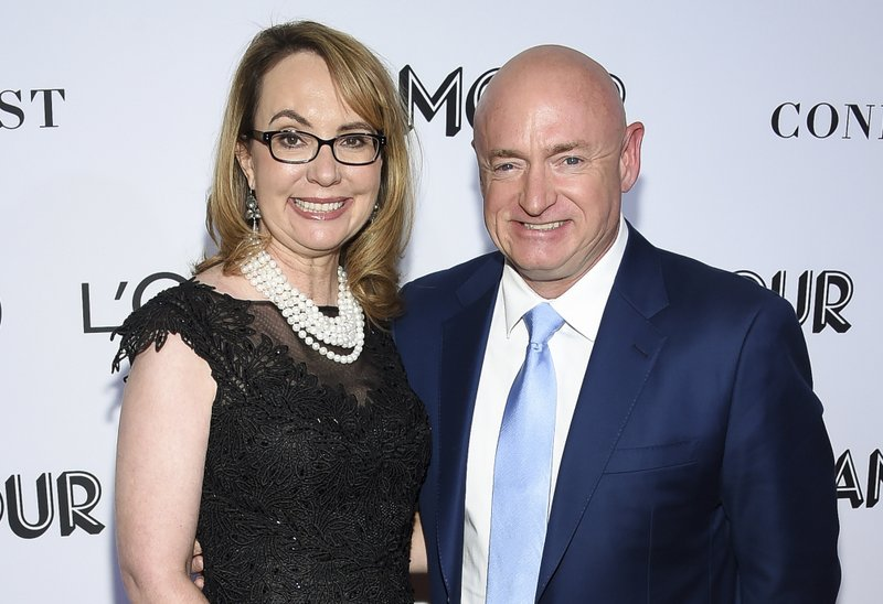 FILE- In this Nov. 12, 2018, file photo politician and gun control advocate Gabrielle Giffords and husband, retired astronaut Mark Kelly, attend the Glamour Women of the Year Awards at Spring Studios in New York. (Photo by Evan Agostini/Invision/AP, File)
