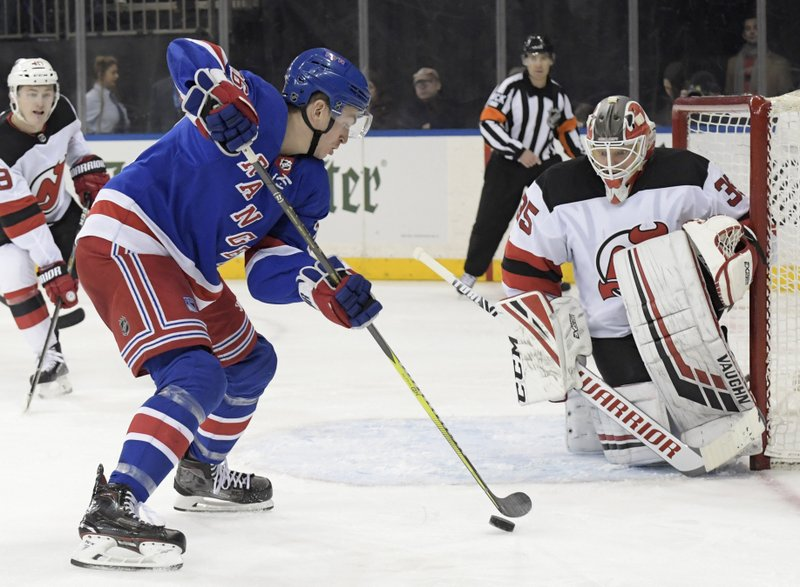 New York Rangers left wing Jimmy Vesey (26) skates in on New Jersey Devils goaltender Cory Schneider (35) during the second period of an NHL hockey game Saturday, Feb. (AP Photo/ Bill Kostroun)