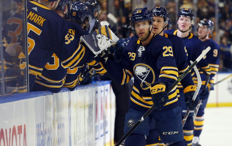 Buffalo Sabres forward Jason Pominville (29) celebrates his goal with teammates during the first period of an NHL hockey game against the Washington Capitals, Saturday, Feb. (AP Photo/Jeffrey T. Barnes)