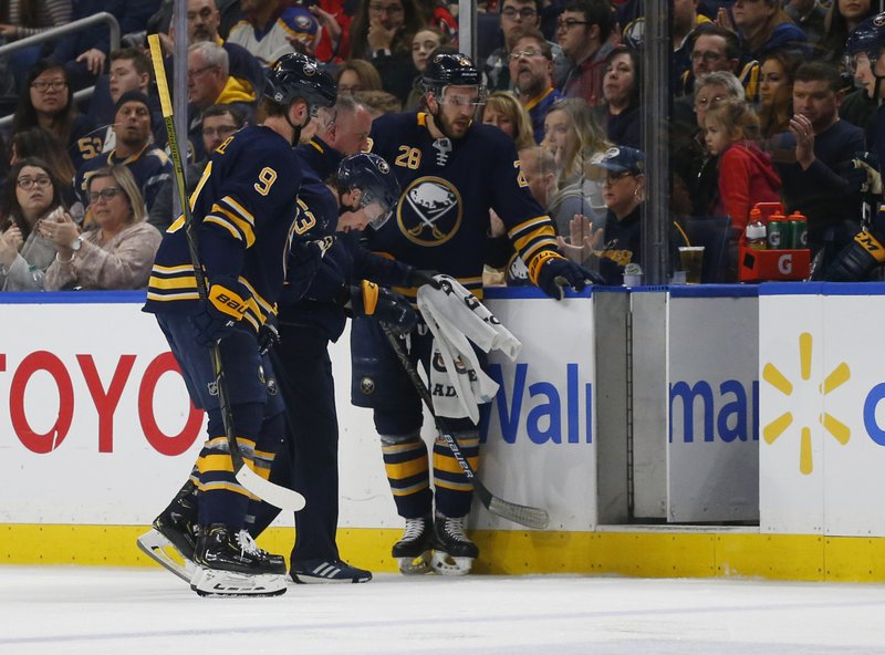 Buffalo Sabres forward Jack Eichel (9) helps forward Jeff Skinner (53) off the ice during the second period of an NHL hockey game against the Washington Capitals, Saturday, Feb. (AP Photo/Jeffrey T. Barnes)