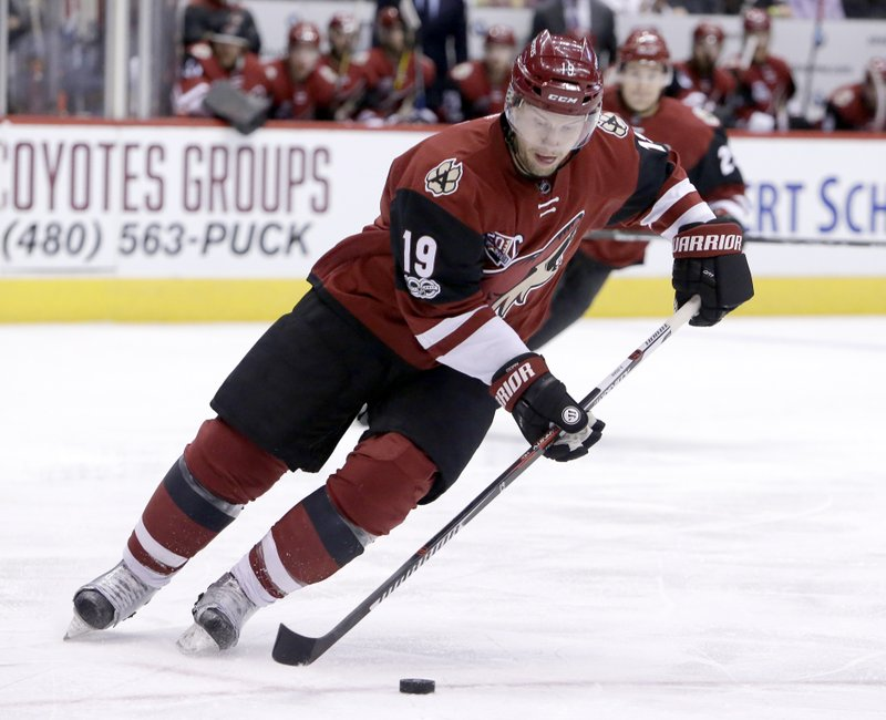 FILE - In this Feb. 26, 2017, file photo, Arizona Coyotes right wing Shane Doan (19) skates with the puck during the first period during an NHL hockey game against the Buffalo Sabres in Glendale, Ariz. (1,540), goals (402), assists (570), points (972), game-winning goals (69) and power-play goals (128).  (AP Photo/Rick Scuteri, File)