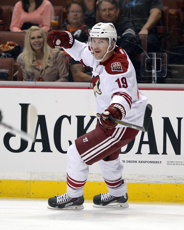FILE - In this Nov. 6, 2013, file photo, Phoenix Coyotes right wing Shane Doan celebrates his goal during the first period of their NHL hockey game against the Anaheim Ducks in Anaheim, Calif. (1,540), goals (402), assists (570), points (972), game-winning goals (69) and power-play goals (128).   (AP Photo/Mark J. Terrill, FIle)