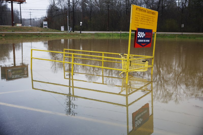 Middle Valley Plaza is seen flooded in Soddy-Daisy, Tenn., Saturday, Feb. 23, 2019, after heavy rain overnight. (Doug Strickland/Chattanooga Times Free Press via AP)