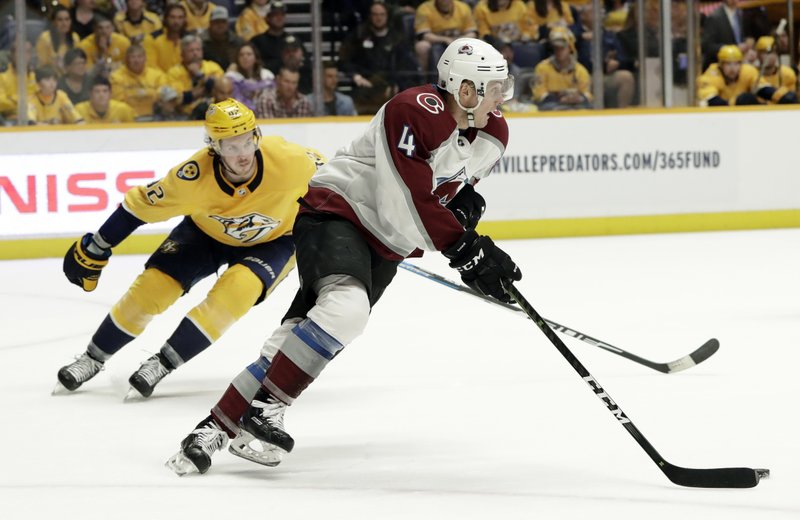 Colorado Avalanche defenseman Tyson Barrie (4) takes the puck past Nashville Predators center Ryan Johansen (92) during the second period of an NHL hockey game Saturday, Feb. (AP Photo/Mark Humphrey)