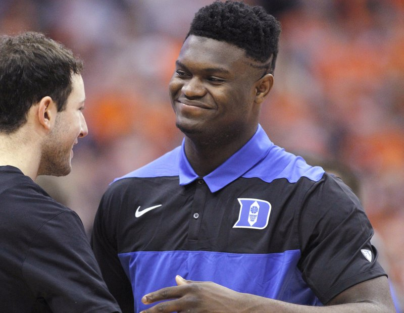 Duke's Zion Williamson, right, is greeted by a teammate on the court before the team's NCAA college basketball game against Syracuse in Syracuse, N. (AP Photo/Nick Lisi)