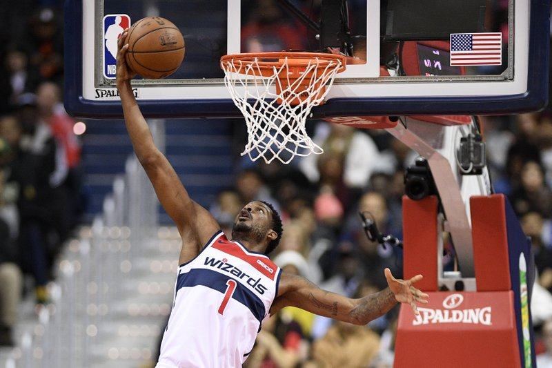 Washington Wizards forward Trevor Ariza (1) goes to the basket during the first half of the team's NBA basketball game against the Indiana Pacers, Saturday, Feb. (AP Photo/Nick Wass)