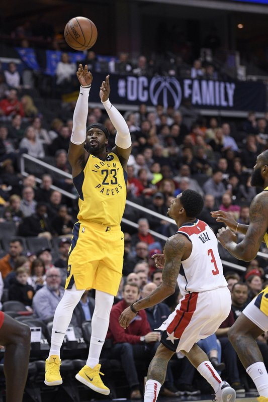 Indiana Pacers guard Wesley Matthews (23) shoots next to Washington Wizards guard Bradley Beal (3) during the first half of an NBA basketball game Saturday, Feb. (AP Photo/Nick Wass)