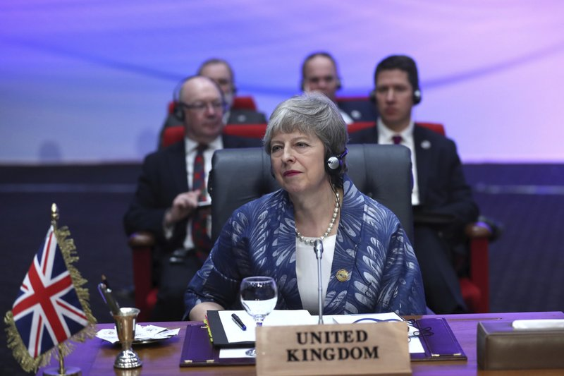 British Prime Minister Theresa May attends a meeting of leaders at an EU-Arab summit at the Sharm El Sheikh convention center in Sharm El Sheikh, Egypt, Sunday, Feb. (AP Photo/Francisco Seco)