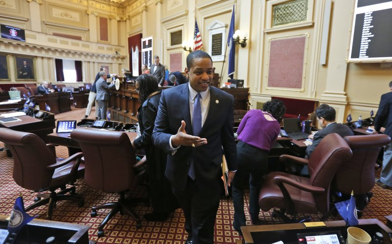 Virginia Lt. Gov. Justin Fairfax exits the floor after the Senate adjourned their 2019 session at the Capitol in Richmond, Va. (AP Photo/Steve Helber)