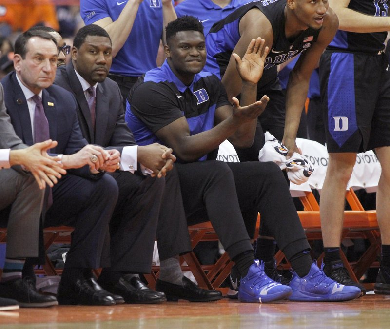 Duke's Zion Williamson, center, cheers after a basket from the bench during the second half of an NCAA college basketball game against Syracuse in Syracuse, N. (AP Photo/Nick Lisi)