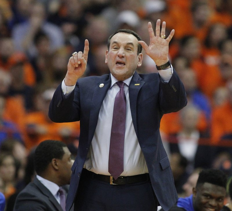 Duke coach Mike Krzyzewski signals to his players during the second half of an NCAA college basketball game against Syracuse in Syracuse, N. (AP Photo/Nick Lisi)