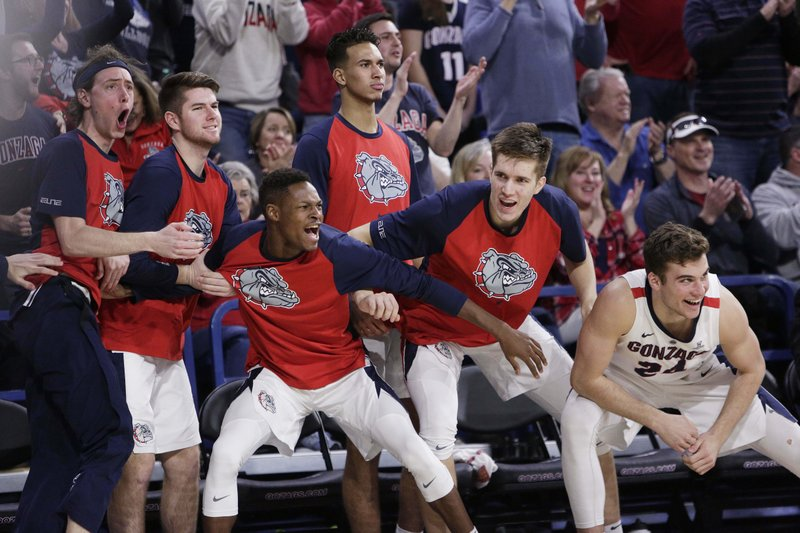 Players on the Gonzaga bench celebrate during the second half of an NCAA college basketball game against BYU in Spokane, Wash. (AP Photo/Young Kwak)