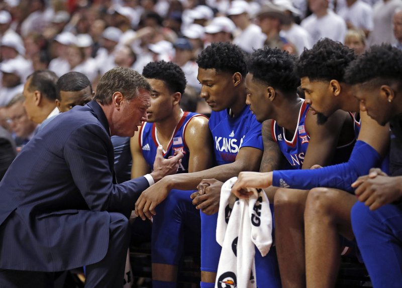 Kansas coach Bill Self talks to his players on the bench during the second half of the team's NCAA college basketball game against Texas Tech, Saturday, Feb. (AP Photo/Brad Tollefson)