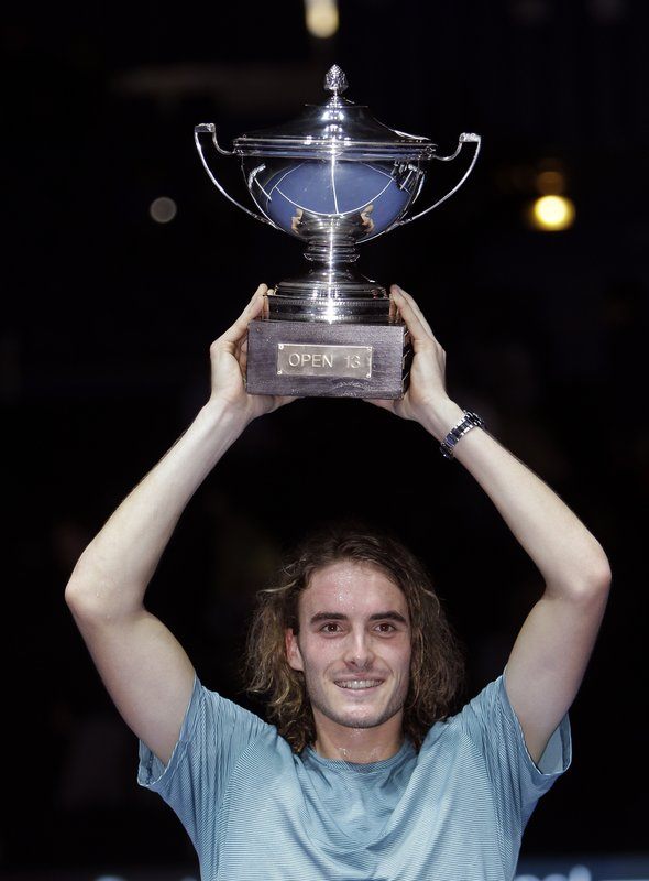 Stefanos Tsitsipas of Greece holds his trophy after defeating Mikhail Kukushkin of Kazakhstan in the final match at the Open 13 Provence tennis tournament in Marseille, southern France, Sunday Feb. (AP Photo/Claude Paris)