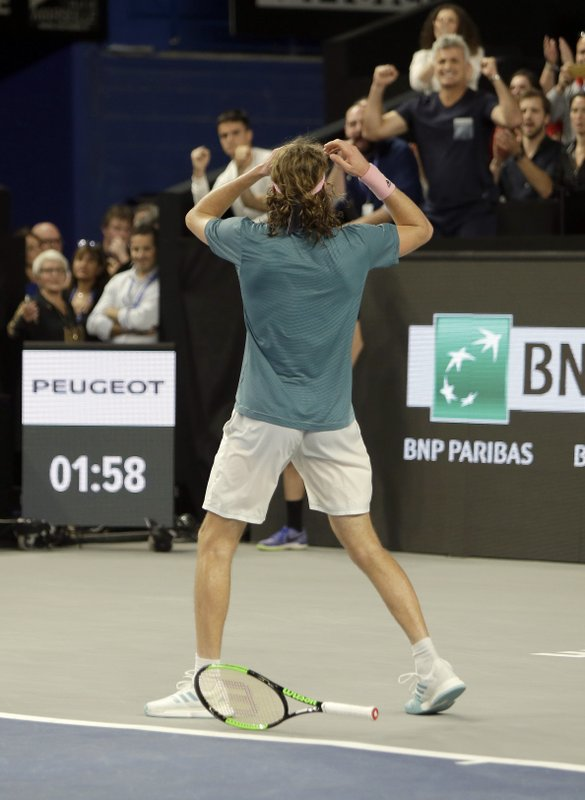 Stefanos Tsitsipas of Greece celebrates after defeating Mikhail Kukushkin of Kazakhstan during their final match at the Open 13 Provence tennis tournament in Marseille, southern France, Sunday Feb. (AP Photo/Claude Paris)