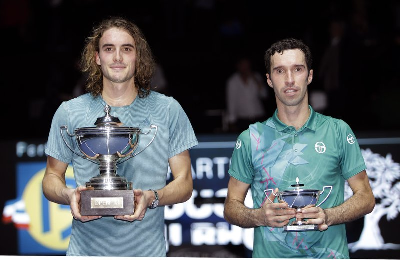 Stefanos Tsitsipas of Greece winner, left, and Mikhail Kukushkin of Kazakhstan hold their trophies after their final match at the Open 13 Provence tennis tournament in Marseille, southern France, Sunday Feb. (AP Photo/Claude Paris)