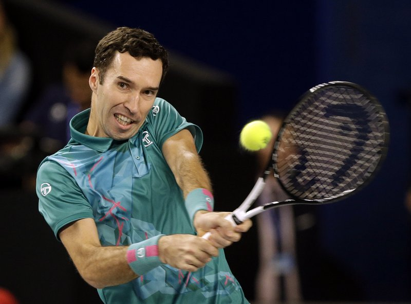 Mikhail Kukushkin of Kazakhstan returns the ball to Stefanos Tsitsipas of Greece during their final match at the Open 13 Provence tennis tournament in Marseille, southern France, Sunday Feb. (AP Photo/Claude Paris)