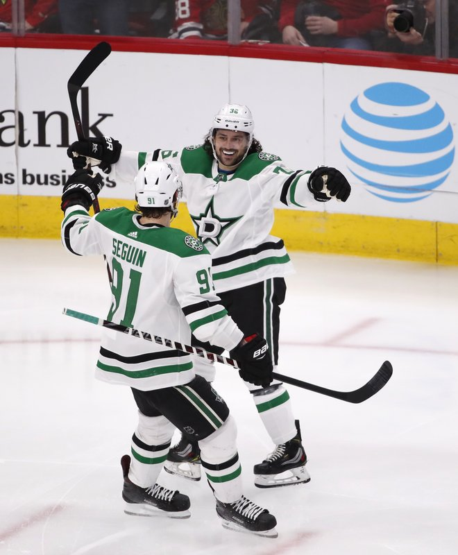 Dallas Stars' Mats Zuccarello celebrates with teammate Tyler Seguin (91) after his goal during the second period of an NHL hockey game against the Chicago Blackhawks Sunday, Feb. (AP Photo/Jeff Haynes)