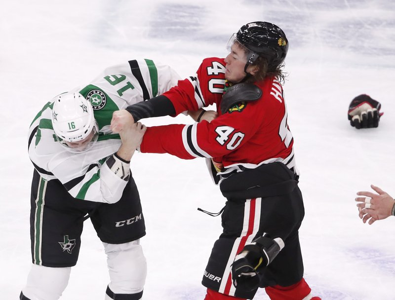 Chicago Blackhawks right wing John Hayden (40) lands a punch on Dallas Stars center Jason Dickinson (16) during a fight in the first period of an NHL hockey game Sunday, Feb. (AP Photo/Jeff Haynes)
