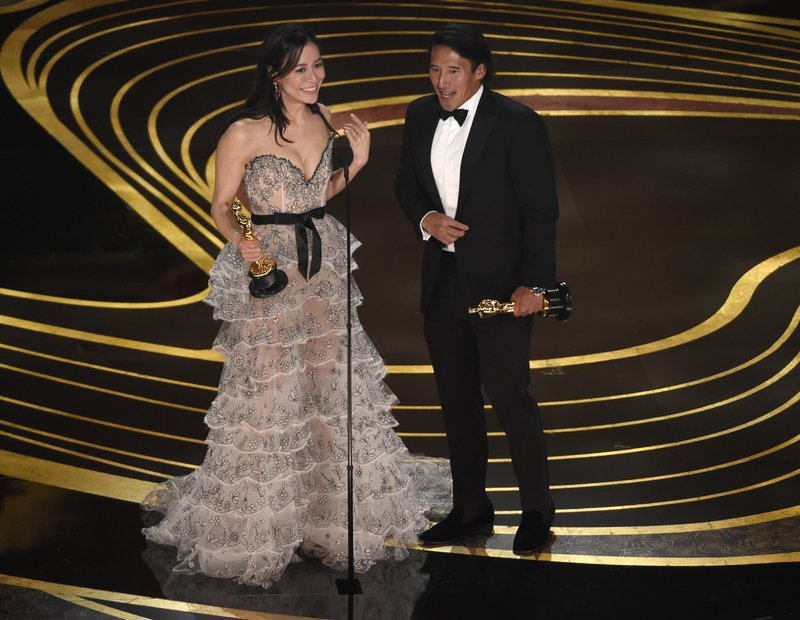Elizabeth Chai Vasarhelyi, left, and Jimmy Chin accept the award for best documentary feature for