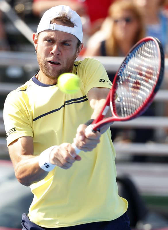 Radu Albot, of Moldova, returns a shot from Daniel Evans, of Britain, during the final tennis match at the Delray Beach Open, Sunday, Feb. (AP Photo/Wilfredo Lee)