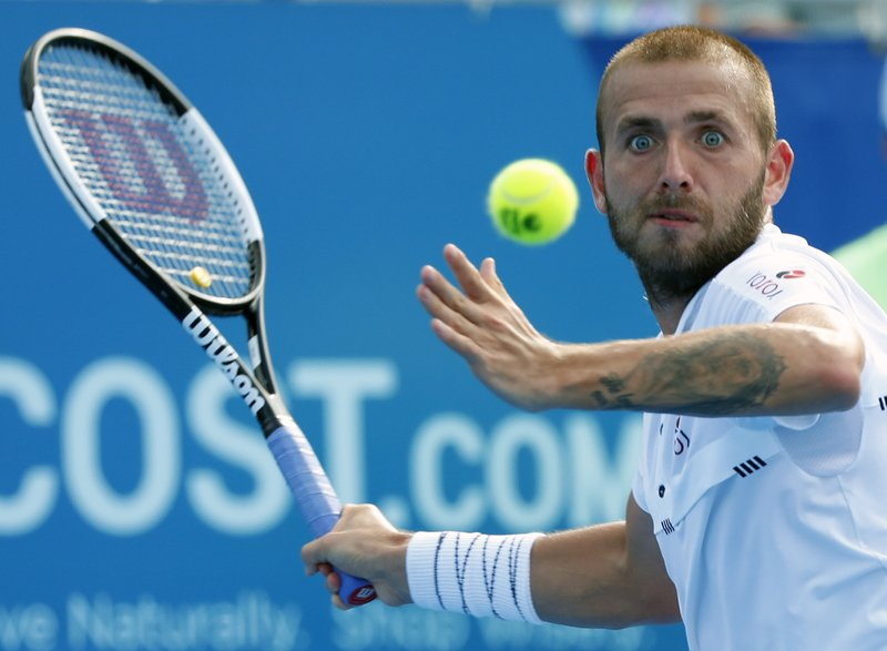 Daniel Evans, of Britain, returns a shot from Radu Albot, of Moldova, during the final tennis match at the Delray Beach Open, Sunday, Feb. (AP Photo/Wilfredo Lee)